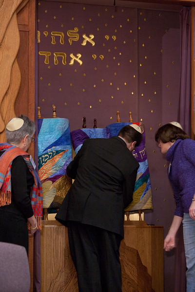 Craig places the new scroll in the ark for the first time
