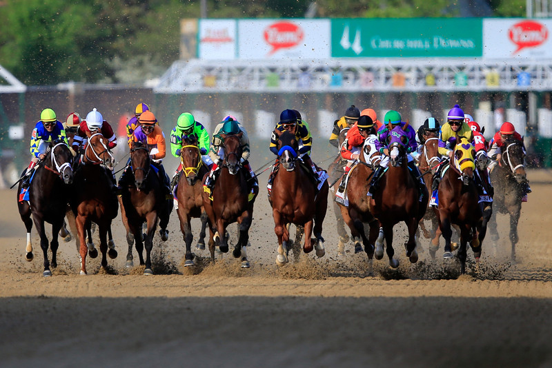 . The field comes out of the starter\'s gate to start the 140th running of the Kentucky Derby at Churchill Downs on May 3, 2014 in Louisville, Kentucky.  (Photo by Rob Carr/Getty Images)