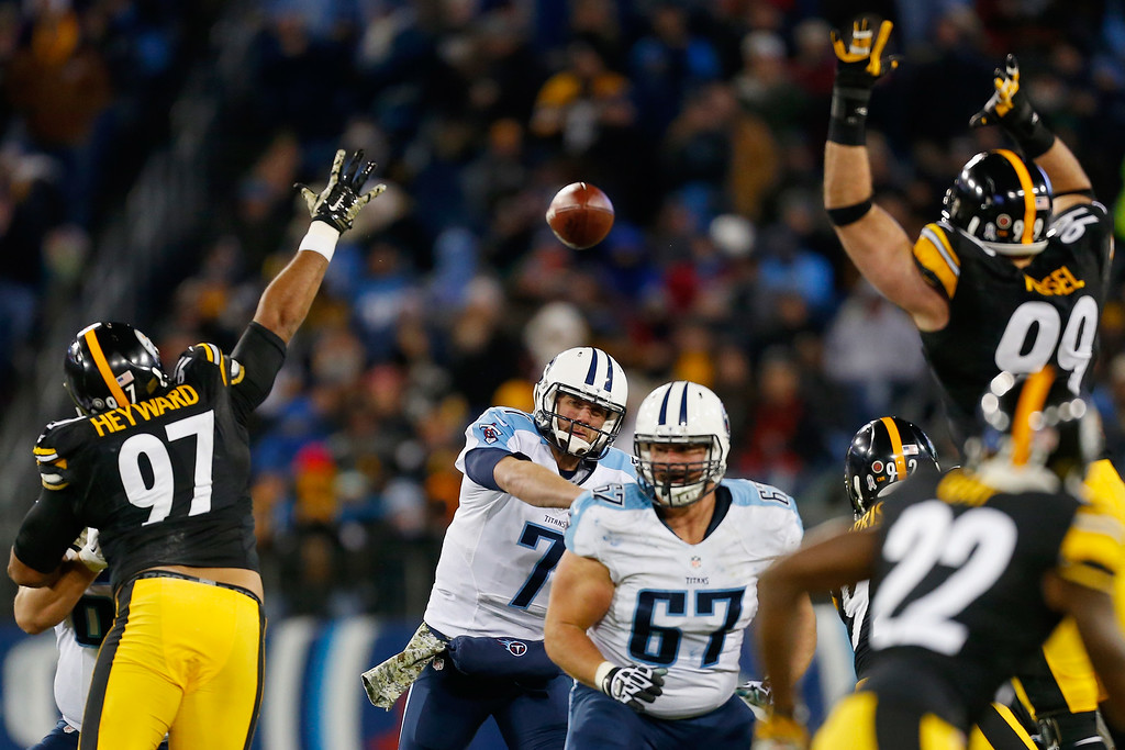 . NASHVILLE, TN - NOVEMBER 17:   Zach Mettenberger #7 of the Tennessee Titans throws a pass against Cameron Heyward #97 and Brett Keisel #99 of the Pittsburgh Steelers during the second quarter of the game at LP Field on November 17, 2014 in Nashville, Tennessee.  (Photo by Wesley Hitt/Getty Images)
