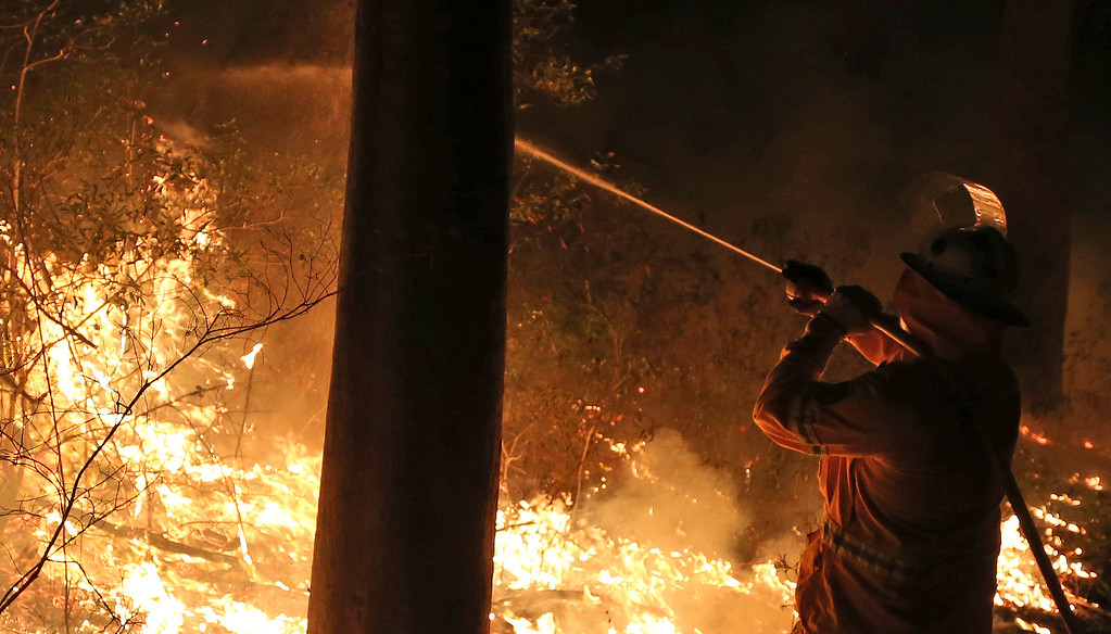 . Firefighters control flames during hazard reduction in Bilpin 75 kilometers (46 miles) from Sydney in  Australia,  Wednesday, Oct. 23, 2013. (AP Photo/Rob Griffith)