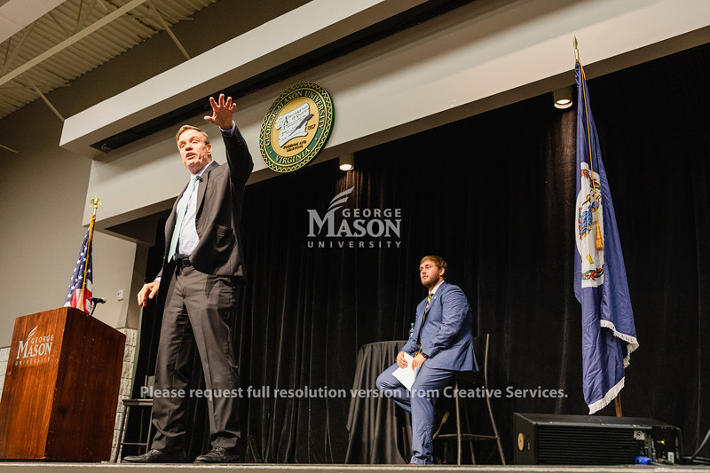 Sen. Mark Warner (D-Va.) speaks as student body president Camden Layton listens during a town hall at George Mason University. Photo by Lathan Goumas/Office of Communications and Marketing   Photo Taken:Friday, September 13, 2019