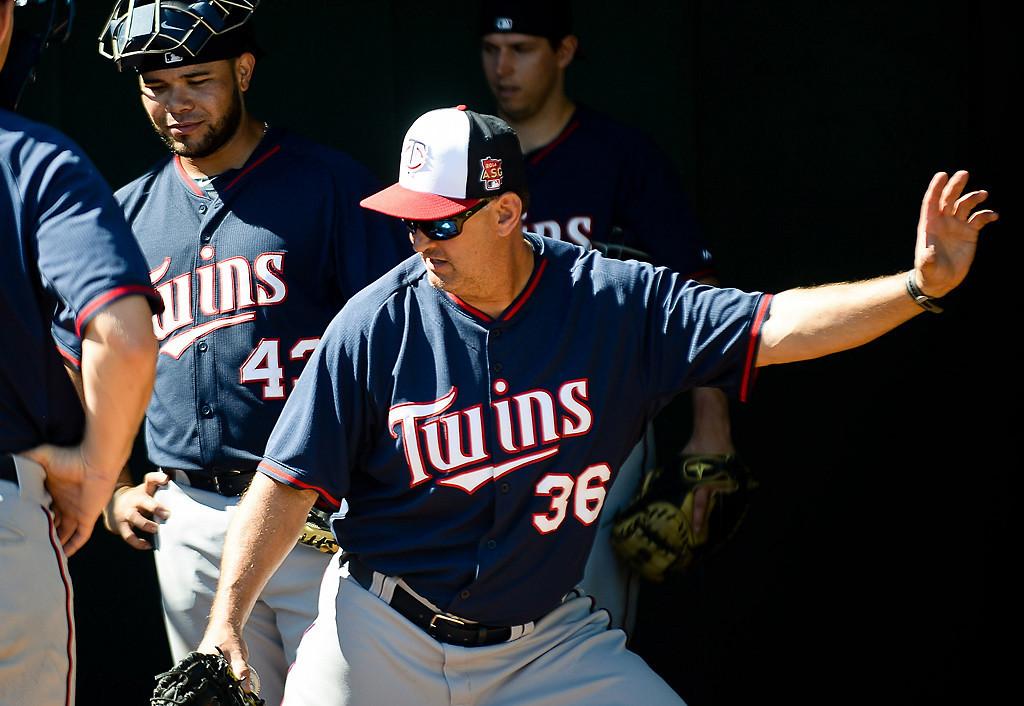 . bench coach Terry Steinbach works on positioning with catchers. (Pioneer Press: Ben Garvin)