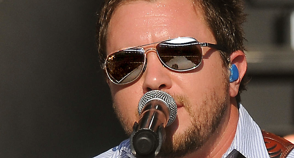 . Target Field is reflected in Mike Eli\'s sunglasses as he performs with the Eli Young Band. (Pioneer Press: John Autey)