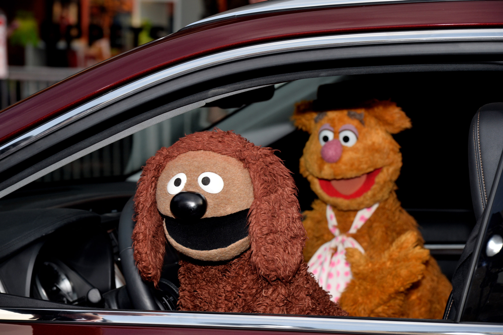 """. Muppets arrive at the premiere of Disney\'s \""""Muppets Most Wanted\"""" at the El Capitan Theatre on March 11, 2014 in Los Angeles, California.  (Photo by Kevin Winter/Getty Images)"""