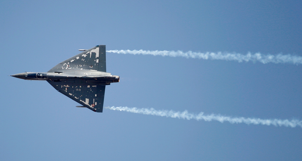 Description of . Indian Air Force single engine, tailless fighter aircraft Tejas performs during rehearsals on the eve of the Aero India 2013 at Yelahanka air base in Bangalore, India, Tuesday, Feb. 5, 2013. Aviation companies from around the world are expected to participate in the five-day event that starts Feb. 6. (AP Photo/Aijaz Rahi)