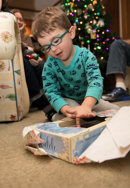 Caleb Playing Ukelele through package.jpg