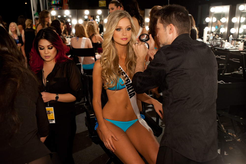 Description of . Miss Australia 2012, Renae Ayris, gets her makeup done by a MAC artist backstage during the 2012 Miss Universe Presentation Show on Thursday, Dec. 13, 2012 at PH Live in Las Vegas. The 89 Miss Universe Contestants will compete for the Diamond Nexus Crown on December 19.  (AP Photo/Miss Universe Organization L.P., LLLP)