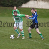 Stephen Daly (Newry Celtic) holds off Millburn's Thoma Beggs. RS1703003