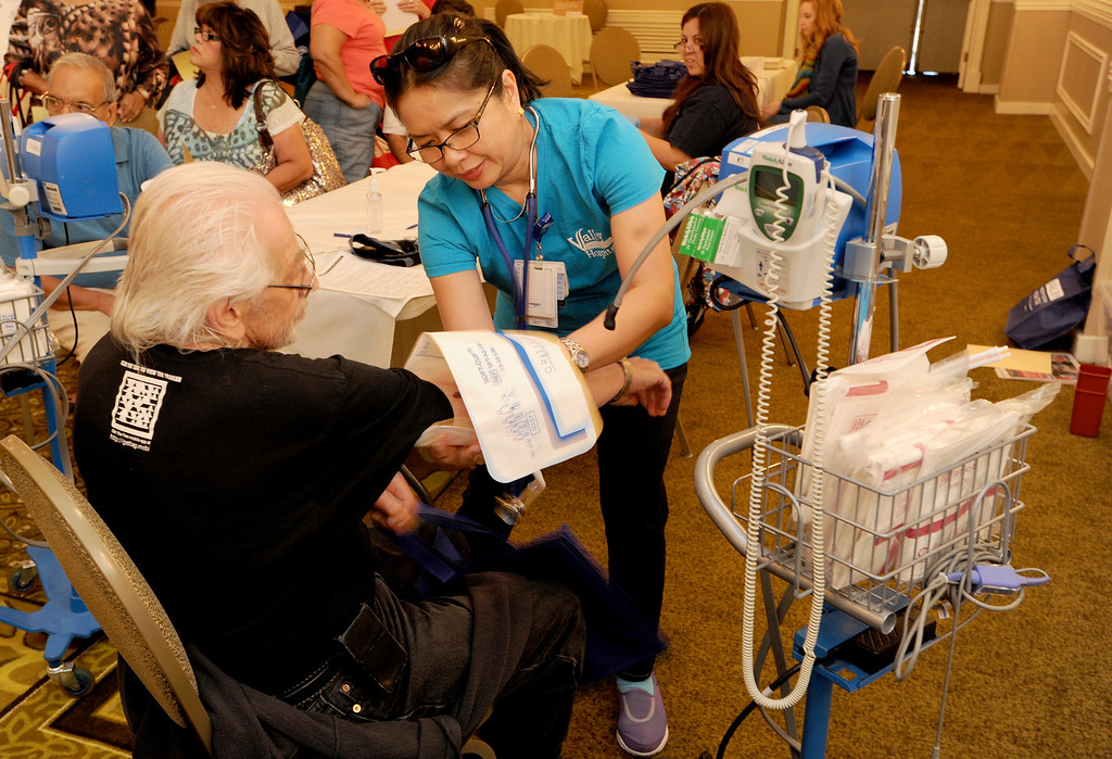 . Herb Eckerling has his blood pressure checked by Carmencita Villanueva, who is a nurse at Valley Presbyterian Hospital. The 4th annual Successful Aging Expo was held Saturday at the Sportsmen�s Lodge Events Center in Studio City, CA. 10/12/2013. photo by (John McCoy/Los Angeles Daily News)