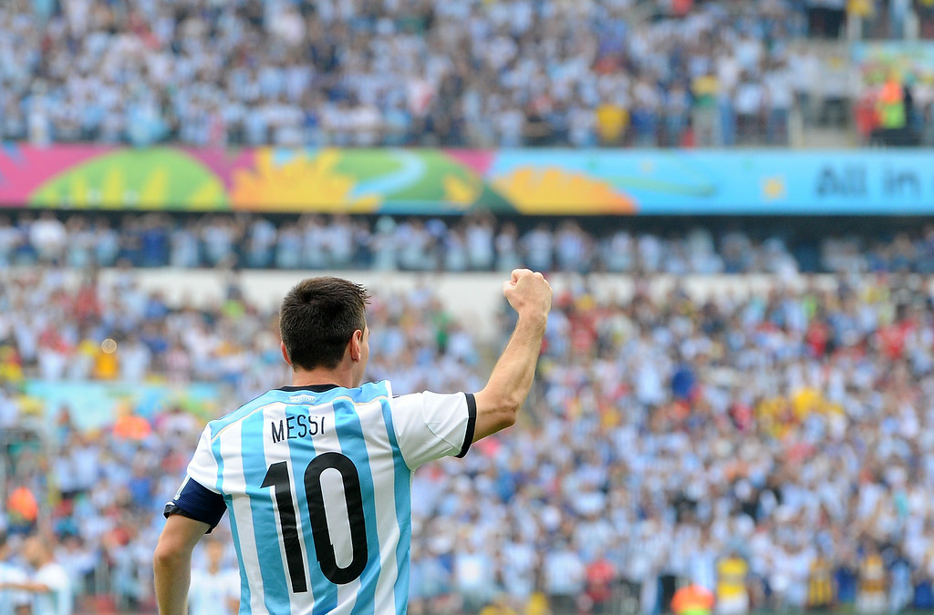 . Argentina\'s forward and captain Lionel Messi celebrates after scoring during the Group F football match between Nigeria and Argentina at the Beira-Rio Stadium in Porto Alegre on June 25, 2014,during the 2014 FIFA World Cup. JEWEL SAMAD/AFP/Getty Images