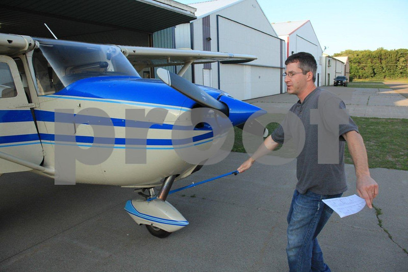 Young civilian pilot performing his pre-flight on a Cessna.