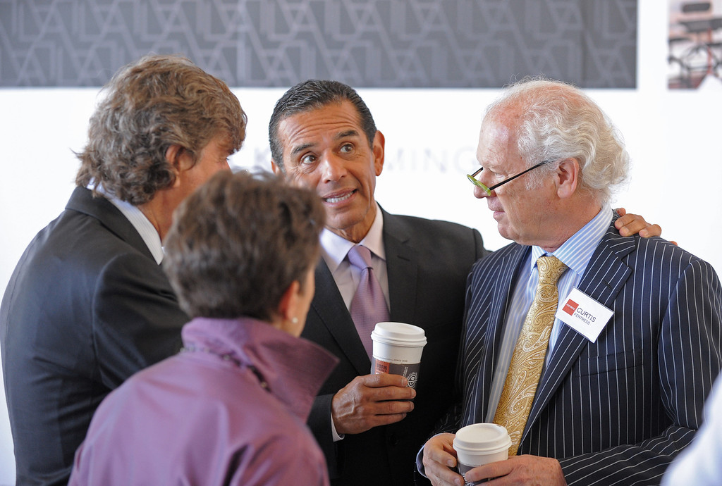 . Mayor Antonio Villaraigosa greets Architect Curtis Fentress, right, as they tour the new TBIT. Media preview of the new Tom Bradley International Terminal at LAX.  Photo by Brad Graverson 6-20-13