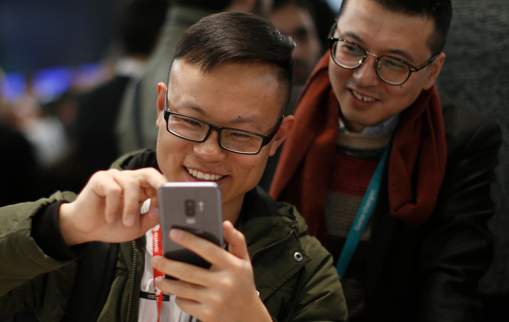 . Visitors use the new Samsung Galaxy S9+ mobile phone during the Mobile World Congress wireless show, in Barcelona, Spain, Tuesday, Feb. 27, 2018. The annual Mobile World Congress (MWC) runs from 26 February - 1 March and draws over 2,300 exhibitors to Barcelona, including industry heavyweights Samsung, Huawei and Nokia. (AP Photo/Manu Fernandez)