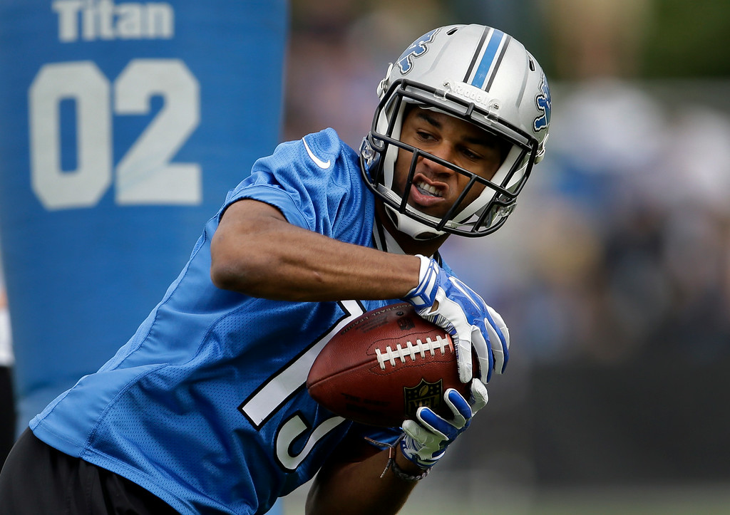 . Detroit Lions wide receiver Golden Tate catches a pass during NFL football training camp in Allen Park, Mich., Monday, July 28, 2014. (AP Photo/Paul Sancya)