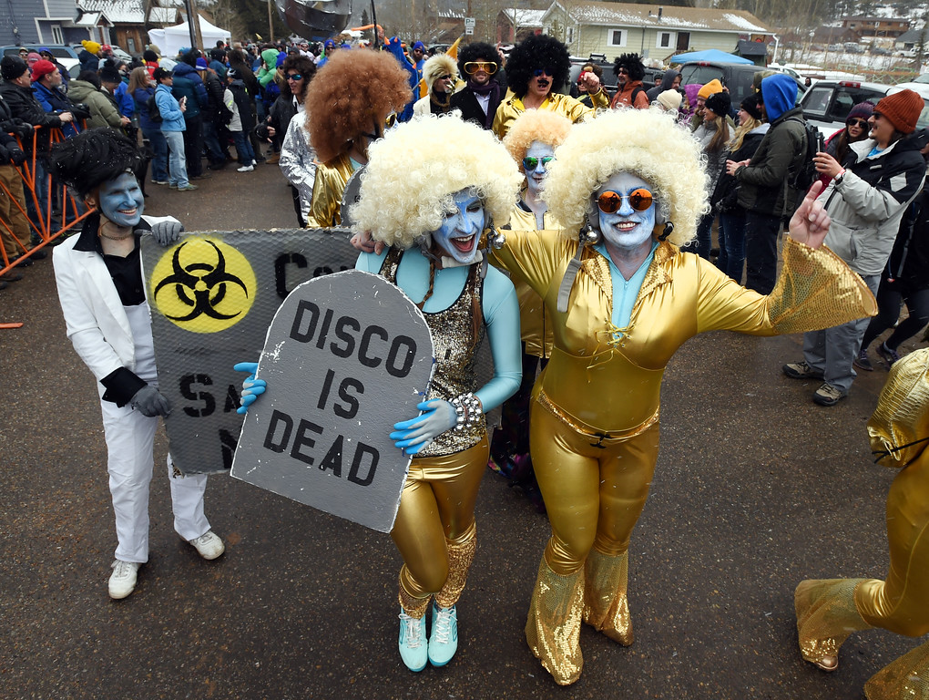 """. Lindsay Hislop, left, with the Disco is Dead sign, and her mother, Deanne Hislop, are part of the \""""Solid Cold Dance team\"""" on Saturday during 2018 Frozen Dead Guy Days in Nederland. The festival continues on Sunday. For more photos, go to dailycamera.com. Cliff Grassmick  Photographer  March 10, 2018"""