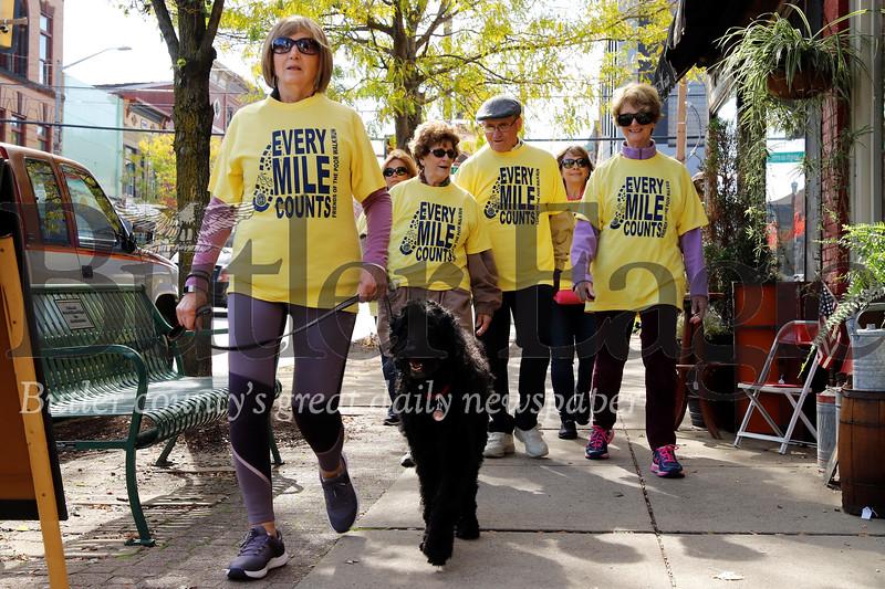 St. Vincent de Paul Friends of the Poor walkers walk down Main St. in Butler Saturday. Seb Foltz/Butler Eagle