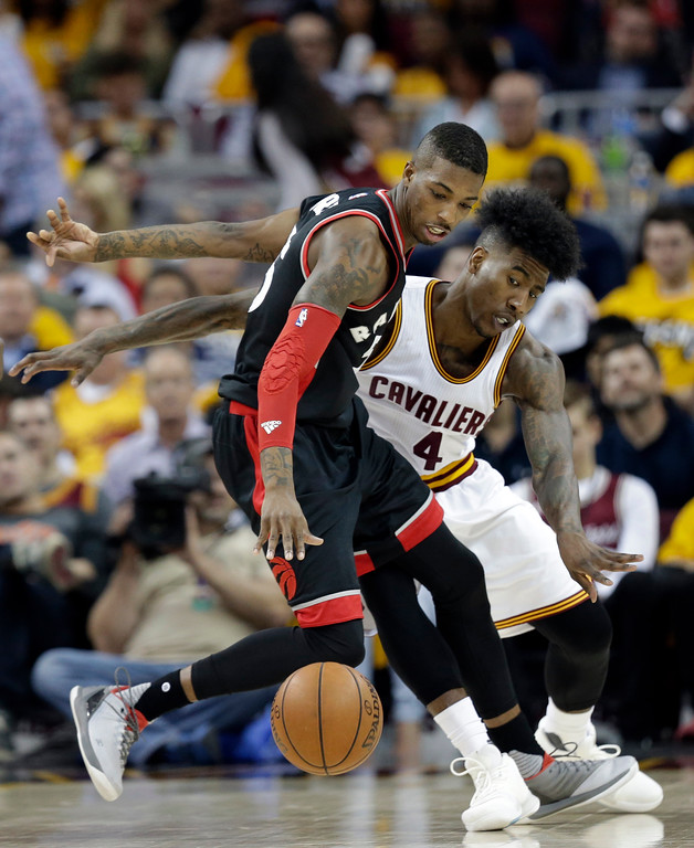 . Toronto Raptors\' Delon Wright, front, drives against Cleveland Cavaliers\' Iman Shumpert in the second half in Game 1 of a second-round NBA basketball playoff series,, Monday, May 1, 2017, in Cleveland. The Cavaliers won 116-105. (AP Photo/Tony Dejak)
