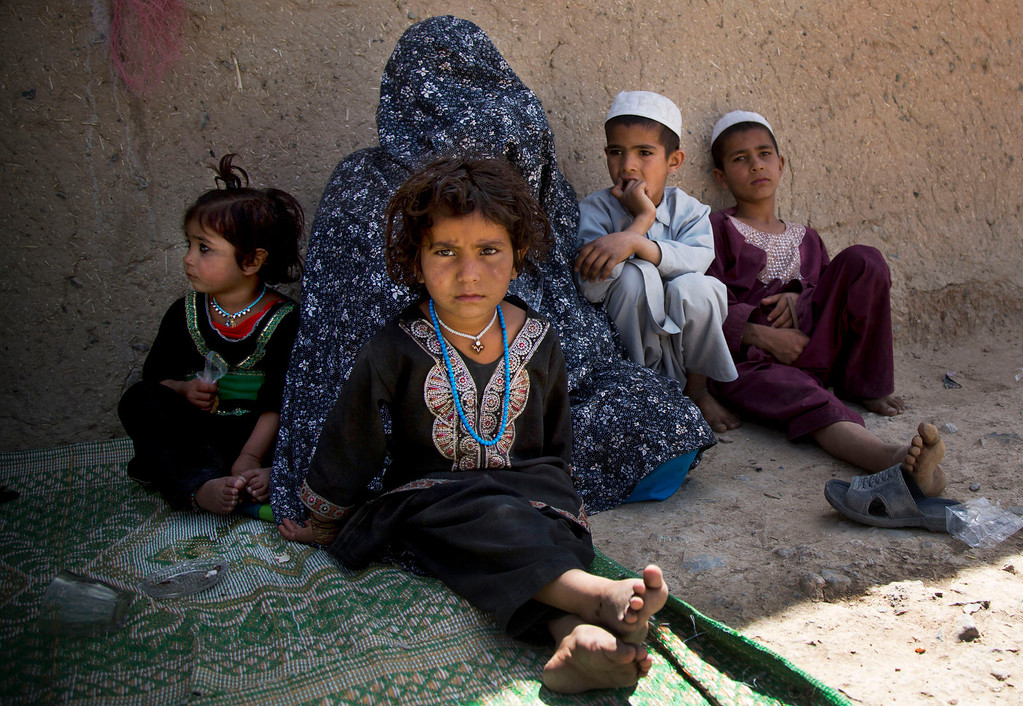 . Masooma sits with her children at her brother-in-law\'s house on the outskirts of Kandahar, Afghanistan on Saturday, April 20, 2013. In an interview, Masooma recounted the events of pre-dawn March 11, 2012 when she says a U.S. soldier rampaged through two villages killing 16 people, including her husband. U.S. Army Staff Sgt. Robert Bales of Lake Tapps, Washington, is accused of the killings. Bales has not entered a plea, but his lawyers have not disputed his involvement in the killings. The Army is seeking the death penalty. (AP Photo/Anja Niedringhaus)