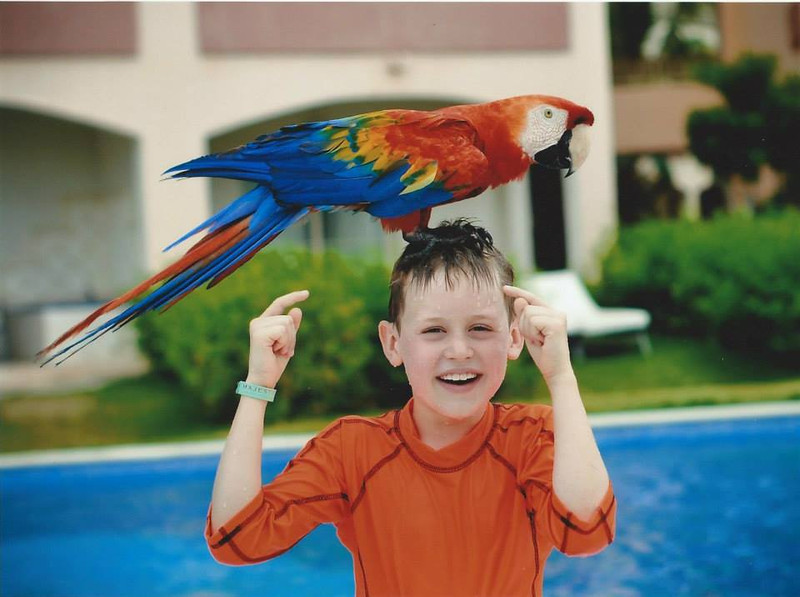 Aaron with parrot on head - DR '13.jpg