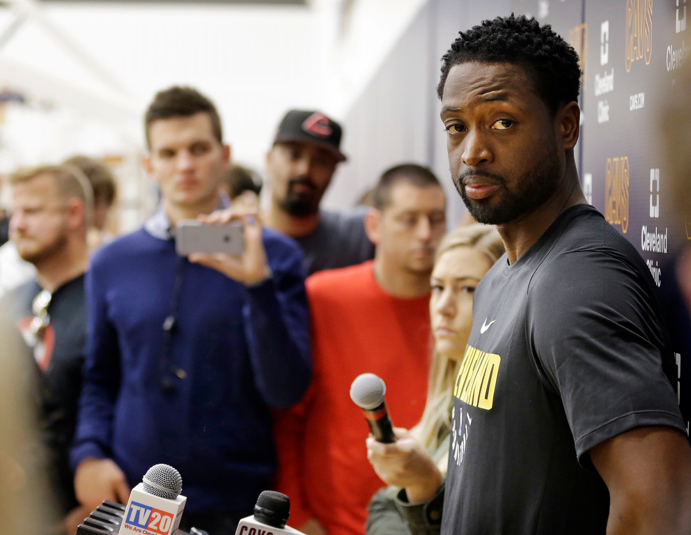 . Cleveland Cavaliers\' Dwyane Wade answers questions during a news conference at the NBA basketball team\'s training facility, Friday, Sept. 29, 2017, in Independence, Ohio. Wade once convinced LeBron James that Miami was the place to be. Seven years later, James lured Wade to Ohio for the chance to win another NBA title, together. (AP Photo/Tony Dejak)