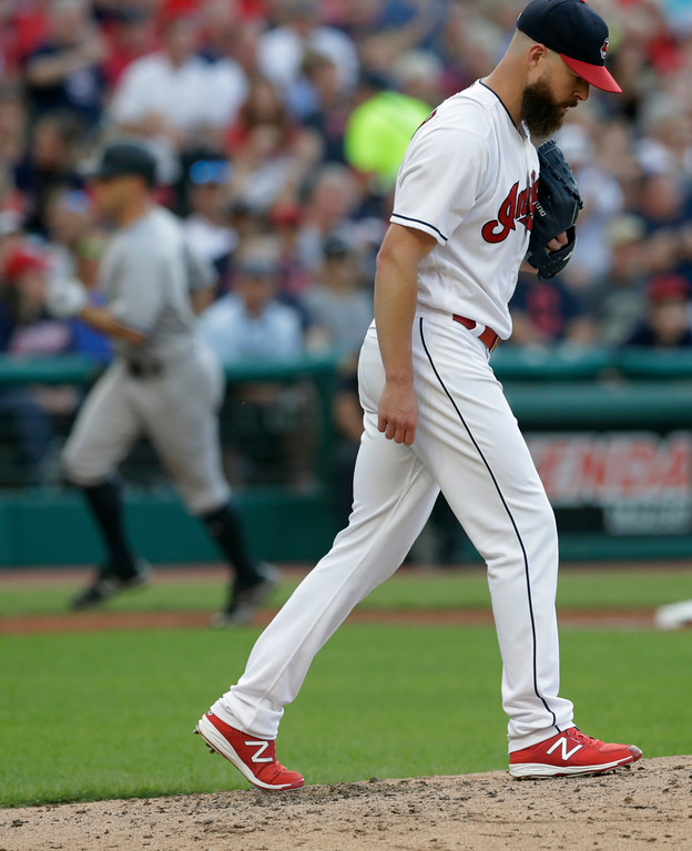 . Cleveland Indians starting pitcher Corey Kluber, right, waits for New York Yankees\' Brett Gardner to run the bases after Gardner hit a two-run home run in the third inning of a baseball game Thursday, July 12, 2018, in Cleveland. (AP Photo/Tony Dejak)