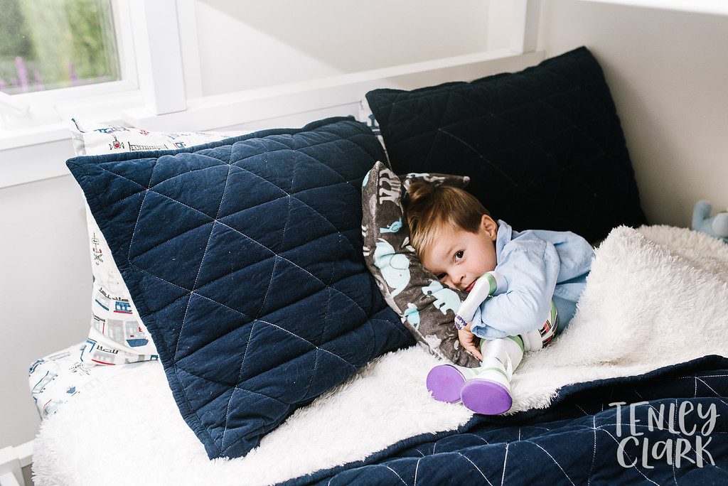 Little boy snuggling Buzz Lightyear. Lifestyle in-home family photoshoot in Marin, CA by Tenley Clark Photography.