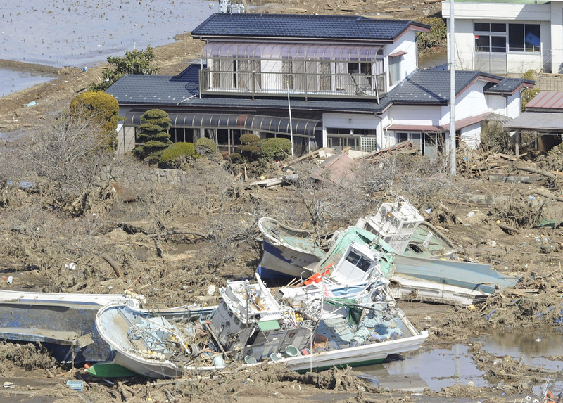 . Fishing boats which were washed out by tsunami are left in Minami Soma, Fukushima, northern Japan Saturday, March 12, 2011 after Japan\'s biggest recorded earthquake slammed into its eastern coast Friday. (AP Photo/Kyodo News)