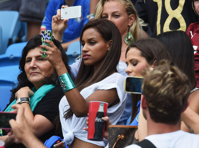 . Mario Balotelli\'s girlfriend Fanny Neguesha takes a photograph prior to the 2014 FIFA World Cup Brazil Group D match between Italy and Uruguay at Estadio das Dunas on June 24, 2014 in Natal, Brazil.  (Photo by Claudio Villa/Getty Images)