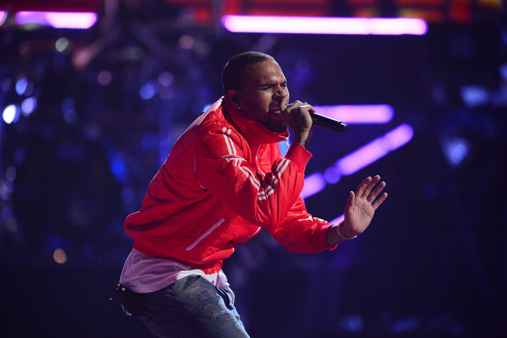 . This Sept. 20, 2013 photo shows Chris Brown performing at the iHeartRadio Music Festival in Las Vegas, Nev. (Photo by Al Powers/Powers Imagery/Invision/AP)