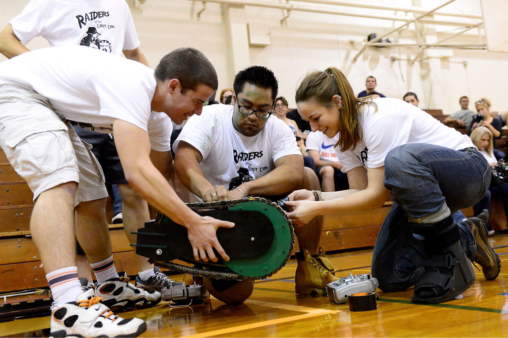 ". The Avengers, from left, Bryan Joel, Richie Hernandez and Erin Evans prepare a vehicle for a round as teams of mechanical engineering Caltech students compete in the annual ME72 Engineering Design Contest at the Pasadena campus Tuesday, March 11, 2014. The goal in ""Raiders of the Lost Can\"" was to move their team\'s can closest to the center of a platform.  The McNuggets came in first. (Photo by Sarah Reingewirtz/Pasadena Star-News)"
