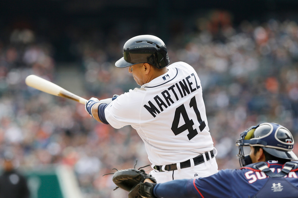 . Detroit Tigers designated hitter Victor Martinez bats during the eighth inning of an opening day baseball game against the Minnesota Twins in Detroit, Monday, April 6, 2015. (AP Photo/Carlos Osorio)