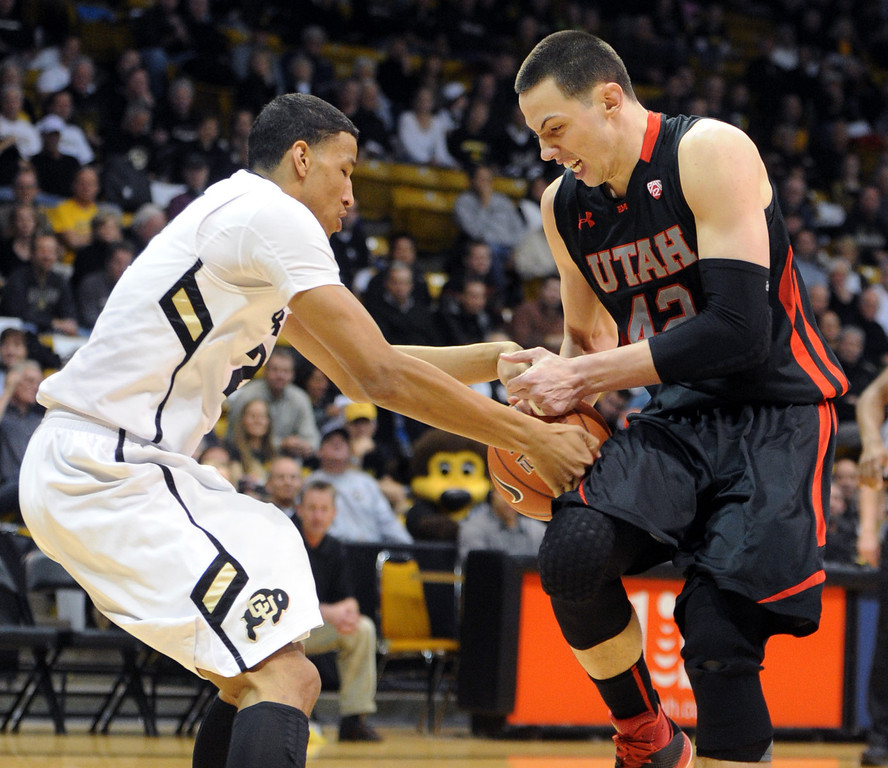 . Andre Roberson, left , tries to tie up Jason Washburn of Utah during the first half of the February 21st, 2013 game in Boulder. For more photos of the game, go to www.dailycamera.com. Cliff Grassmick / February 21, 2013