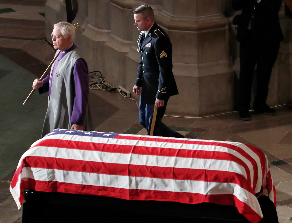 . Jimmy McCain walks from the podium after reading the poem �The Requiem,� at a memorial service for his father, Sen. John McCain, R-Ariz., at Washington National Cathedral in Washington, Saturday, Sept. 1, 2018. McCain died Aug. 25, from brain cancer at age 81. (AP Photo/Pablo Martinez Monsivais)