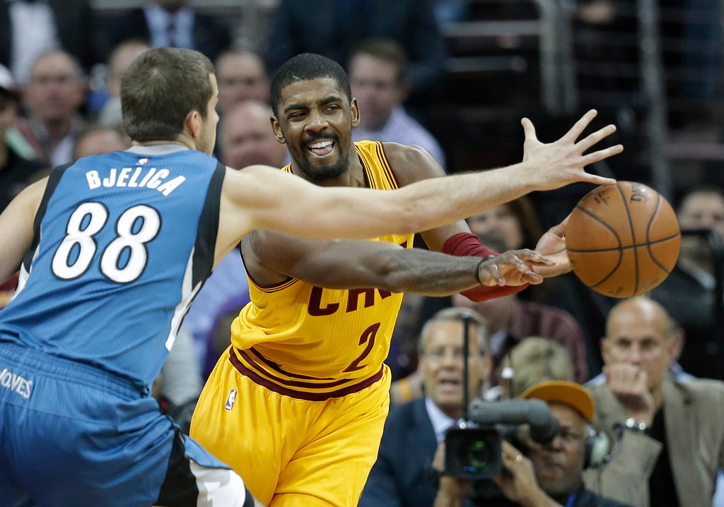 . Cleveland Cavaliers\' Kyrie Irving (2) passes against Minnesota Timberwolves\' Nemanja Bjelica (88), from Serbia, in the first half of an NBA basketball game Monday, Jan. 25, 2016, in Cleveland. (AP Photo/Tony Dejak)