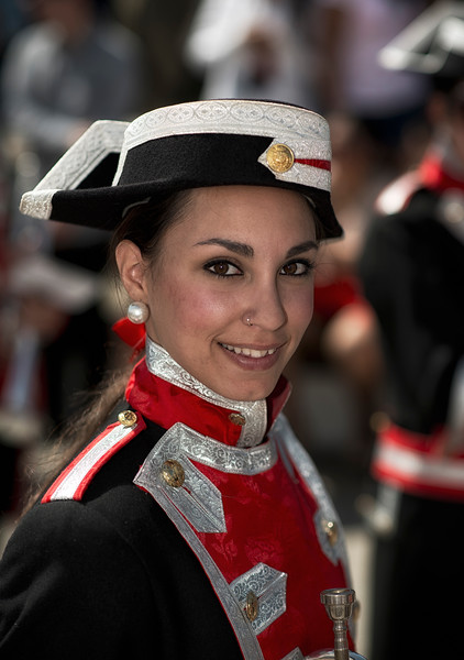 A young Spanish lady member of a marching band.