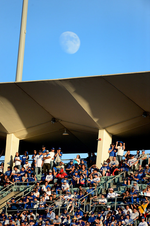 . The moon rises during game 4 of the NLCS at Dodger Stadium Tuesday, October 15, 2013. (Photo by David Crane/Los Angeles Daily News)