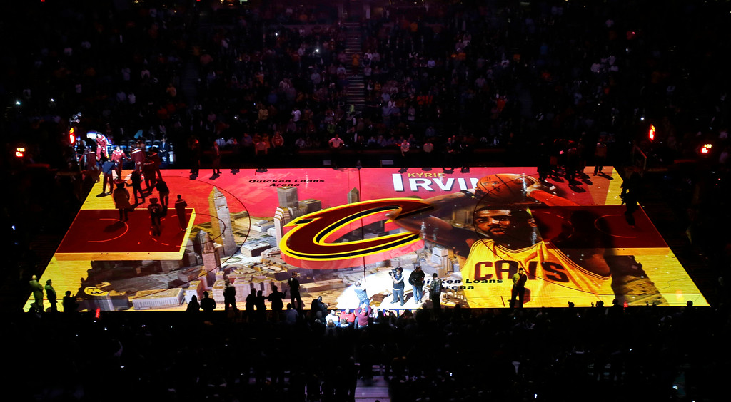 . An image of Cleveland Cavaliers\' Kyrie Irving is projected on the court during introductions before an NBA basketball game against the Toronto Raptors Tuesday, Dec. 9, 2014, in Cleveland. (AP Photo/Mark Duncan)