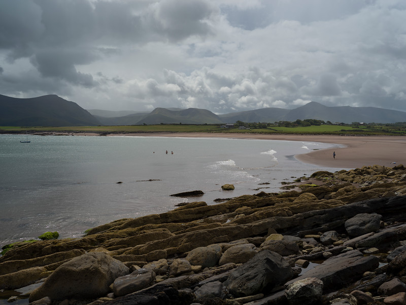 Tourists on the Coumeenoole Beach, Goulane Ard, Brandon, County Kerry, Ireland