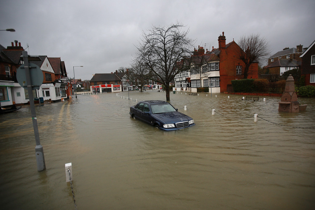 . A Mercedes car sits abandoned in flood water in the High Street  on February 12, 2014 in Datchet, England.The Environment Agency contiues to issue severe flood warnings for a number of areas on the river Thames in the commuter belt west of London. With heavier rains forecast for the coming week people are preparing for the water levels to rise.  (Photo by Peter Macdiarmid/Getty Images)