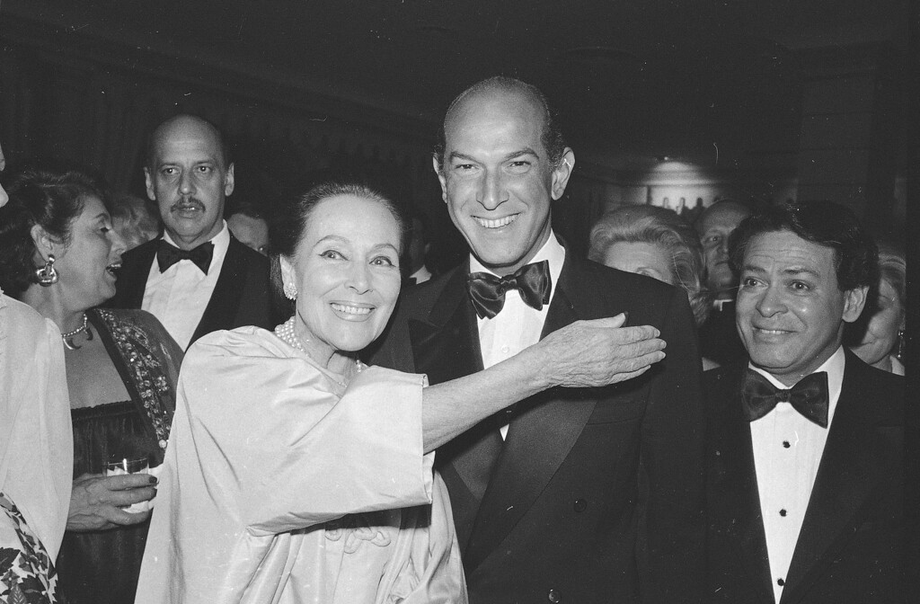 . In this May 7, 1981, file photo, fashion designer Oscar de la Renta and actress Dolores del Rio are pose at the Casita Maria Benefit dinner at the Pierre Hotel in New York where the two were honored. (AP Photo/File)