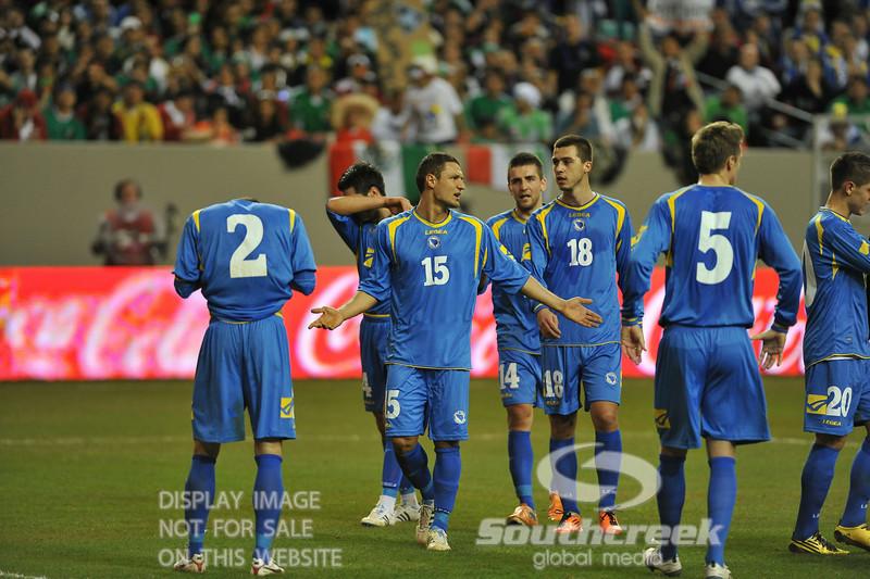Bosnia-Herzegovina's Midfielder Sejad Salihovic (#15) pleads for a call in Soccer action between Bosnia-Herzegovina and Mexico.  Mexico defeated Bosnia-Herzegovina 2-0 in the game at the Georgia Dome in Atlanta, GA.
