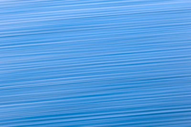 Abstract blue wave patterns streak from side to side