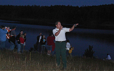 """This final photo is Ranger Lou Conroy near the end of the Moon Walk talking about thebald eagle habitat near Deerfield Reservoir.   Many thanks to Lou Conroy, Amy Ballard, and other Forest Service personnel who helped make the """"Bald Eagle"""" Moon Walk such an enjoyable event.  You can read about previous Moon Walks by clicking on the next several gallery pages.  Or, if you like,  here's a link to all Moon Walk postings on the Black Hills Journal website."""