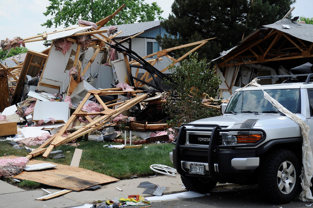 . Debris is scattered after the house explosion on the 9300 block of Ingalls Street in Westminster, Colorado, Thursday afternoon June 13, 2013. Windows were blown out on surrounding home and debris was strewn over all over the neighborhood.(Photo By Andy Cross/The Denver Post)