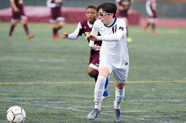e10/29/19 Wesley Bunnell | StaffrrNew Britain soccer was defeated 2-0 by Newington during a drizzle at Veterans Stadium on Tuesday afternoon. Newington's Tyler Ferreira (12).