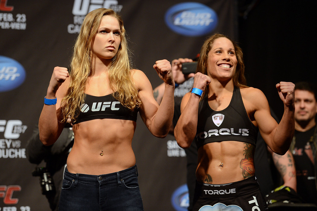 . UFC women�s bantamweight champion Ronda Rousey and challenger Liz Carmouche during weigh-ins for UFC 157 Rousey vs Carmouche at the Honda Center in Anaheim Friday, February  22, 2013.  (Hans Gutknecht/Staff Photographer)