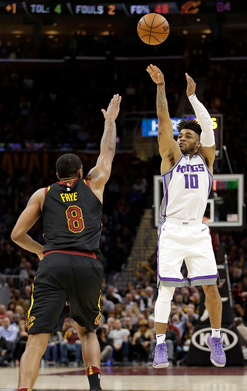 . Sacramento Kings\' Frank Mason III (10) shoots over Cleveland Cavaliers\' Channing Frye (8) in the second half of an NBA basketball game, Wednesday, Dec. 6, 2017, in Cleveland. (AP Photo/Tony Dejak)