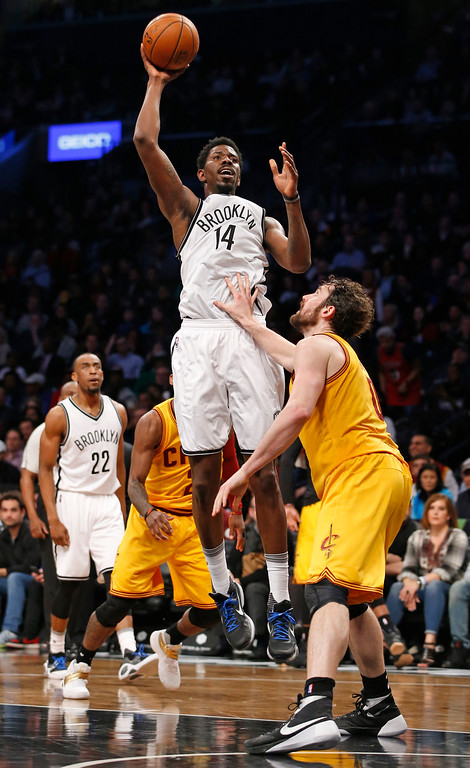 . Brooklyn Nets center Henry Sims (14) shoots over Cleveland Cavaliers forward Kevin Love (0) in the second half of an NBA basketball game, Thursday, March 24, 2016, in New York. The Nets beat the Cavaliers 104-95. (AP Photo/Kathy Willens)