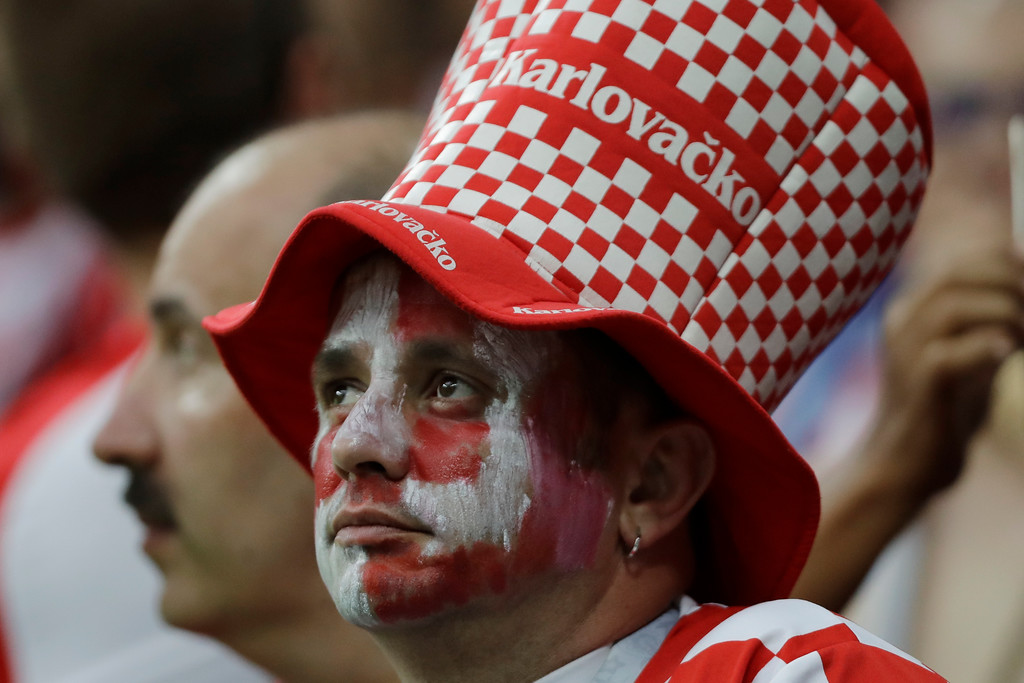 . A fan of Croatia watches the award ceremony after the final match between France and Croatia at the 2018 soccer World Cup in the Luzhniki Stadium in Moscow, Russia, Sunday, July 15, 2018. (AP Photo/Natacha Pisarenko)