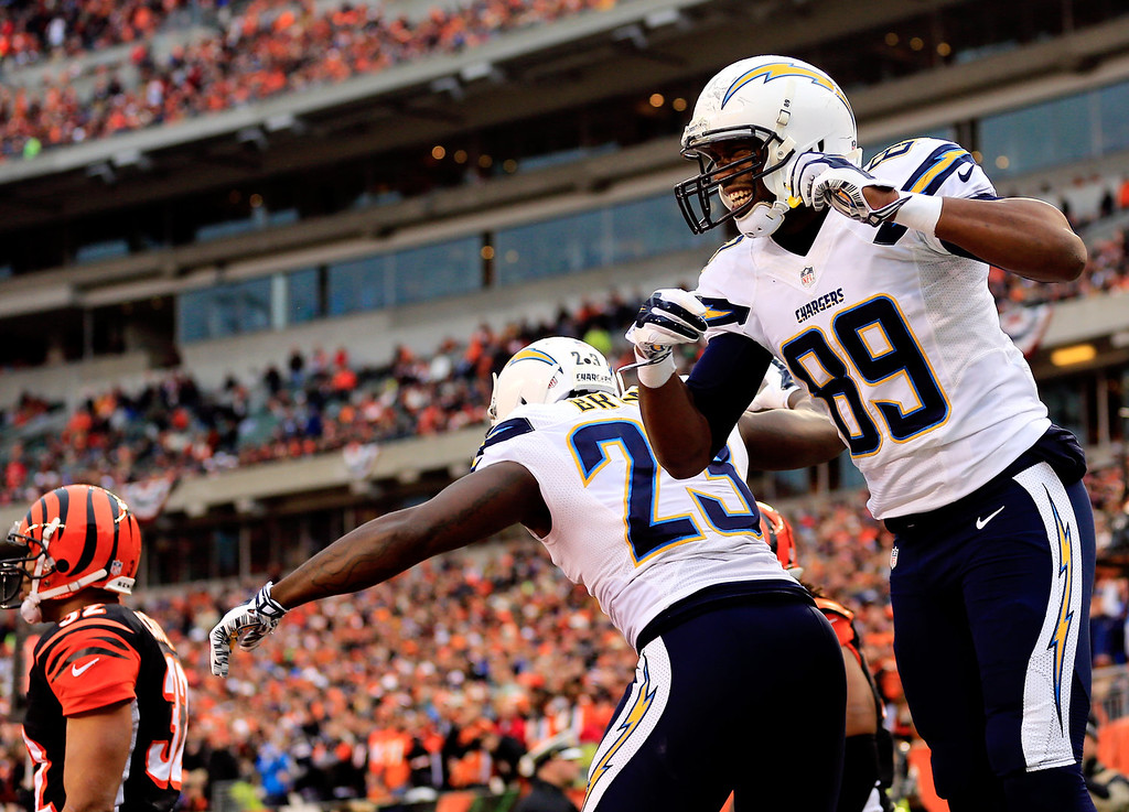 . Tight end Ladarius Green #89 celebrates a third quarter touchdown with running back Ronnie Brown #23 of the San Diego Chargers against the Cincinnati Bengals during a Wild Card Playoff game at Paul Brown Stadium on January 5, 2014 in Cincinnati, Ohio.  (Photo by Rob Carr/Getty Images)